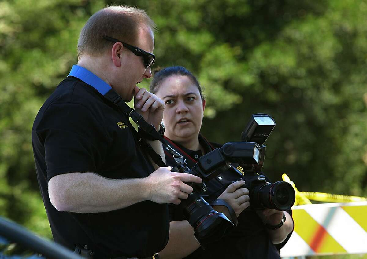 A 51-year-old woman was reported dead around noon today in the kitchen of her residence at 626 Moraga Way in Orinda, Calif., as the sheriff's department take pictures of the home on Tuesday, June 26, 2012. A 62-year-old male suspect was arrested shortly thereafter.