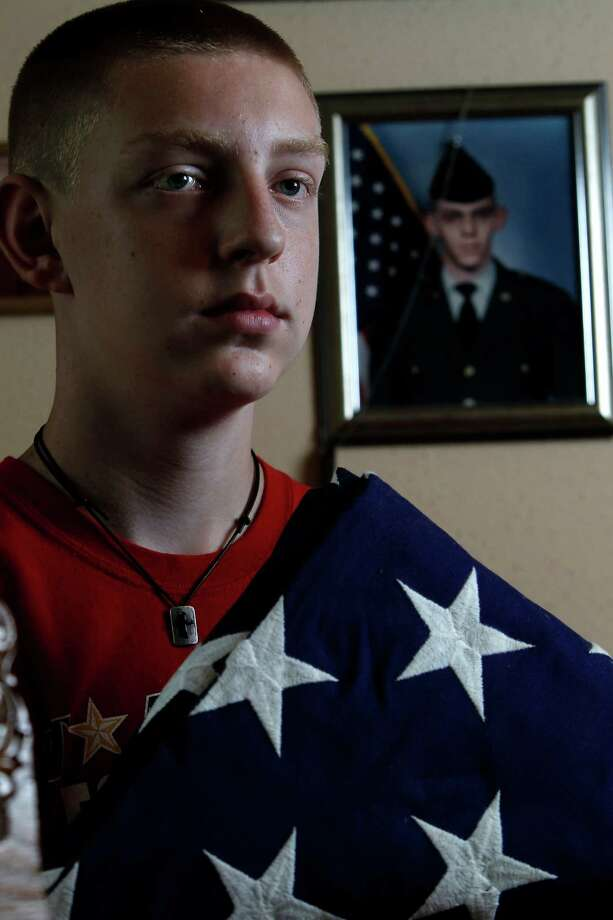 Now 13, Timothy Swenson accepts that his soldier father, David Paul Swenson Jr., killed himself seven years ago. The Humble teen cherishes memories of his dad's return from Iraq in 2004, left, and the flag that later covered his casket. Photo: Karen Warren / © 2012  Houston Chronicle