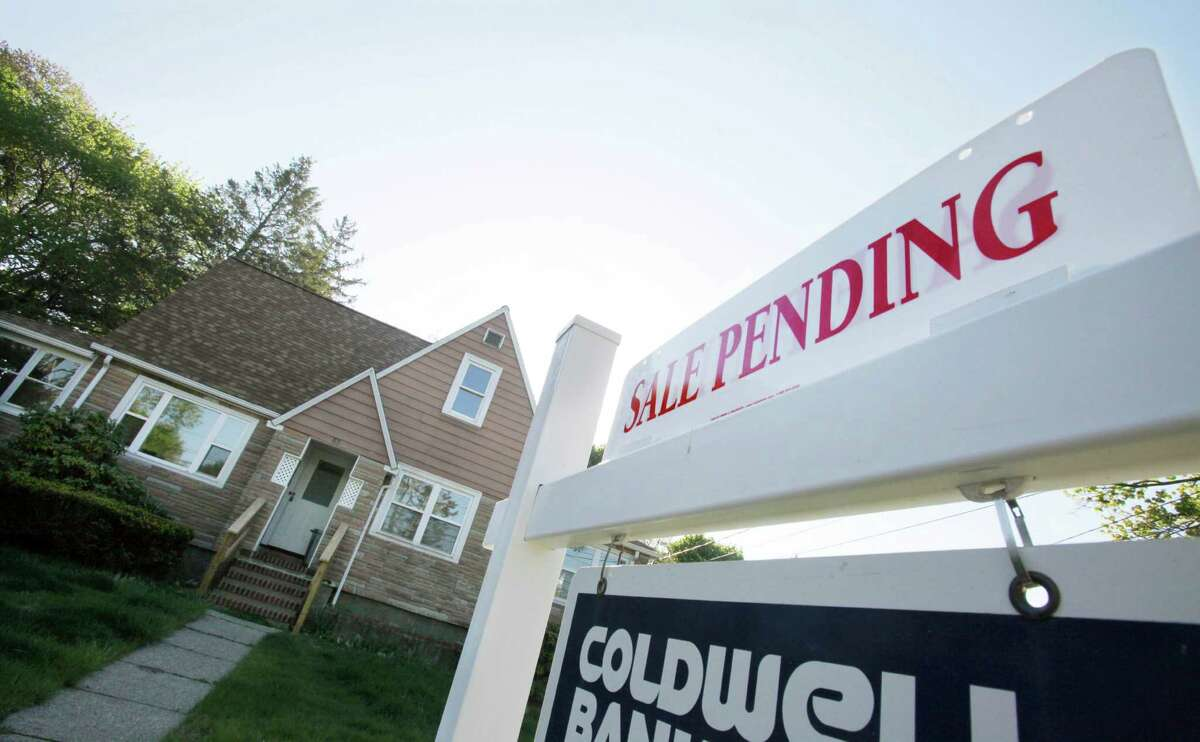 FILE-In this April 26, 2012, file photo, a sign advertises a pending residential real estate sale in Framingham, Mass. Home prices rose in nearly all major U.S. cities in April from March, further evidence that the housing market is slowly improving even while the job market slumps. (AP Photo/Bill Sikes)