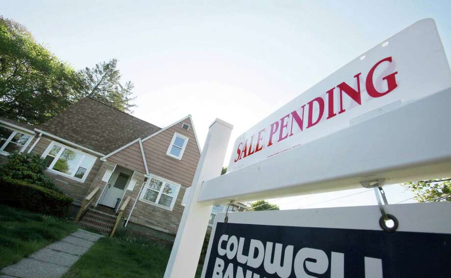 FILE-In this April 26, 2012, file photo, a sign advertises a pending residential real estate sale in Framingham, Mass. Home prices rose in nearly all major U.S. cities in April from March, further evidence that the housing market is slowly improving even while the job market slumps. (AP Photo/Bill Sikes) Photo: Bill Sikes, ASSOCIATED PRESS / AP2012