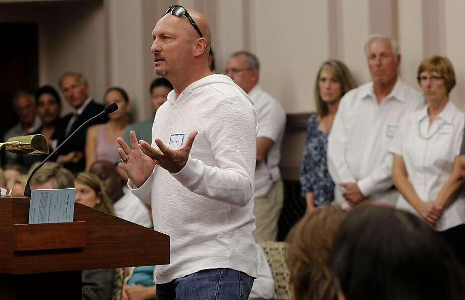 Retiree Gary Jones asks the Stockton City Council not to reduce his health care during comments before a bankruptcy vote. Photo: Michael Macor, The Chronicle