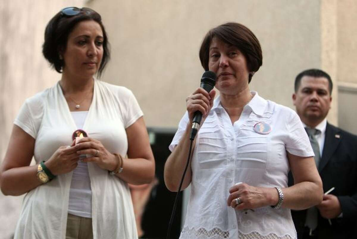 Zangeneh speaks during the candlelight vigil on what would have been her daughter's 31st birthday. With her are Kathy Soltani and HPD Sgt. J.C. Padilla. (James Nielsen / Chronicle)