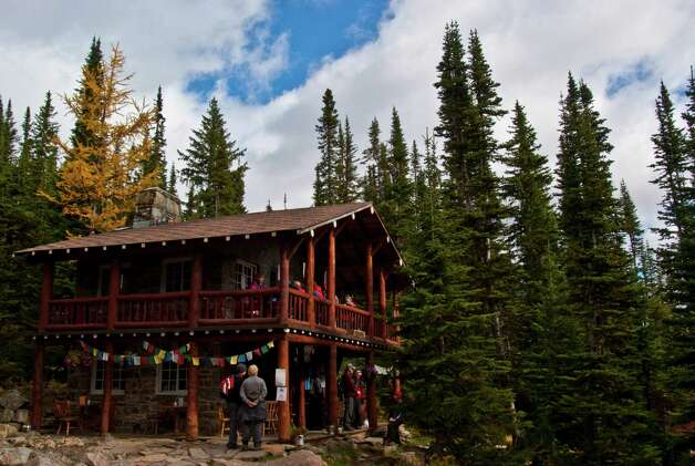 The Plain of Six Glaciers Teahouse is nestled deep in the woods of the Canadian Rockies. Hikers who reach the teahouse can enjoy homemade German chocolate cake and hot beverages while looking out at the mountains. Photo: Joshua Trudell, For The Express-News