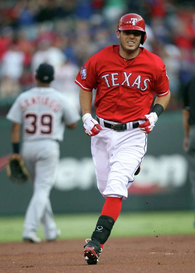 Ian Kinsler of the Rangers rounds the bases after hitting a leadoff home run in the first inning against theTigers on June 26, 2012 at the Rangers Ballpark in Arlington. Photo: Layne Murdoch, Getty Images / 2012 Getty Images
