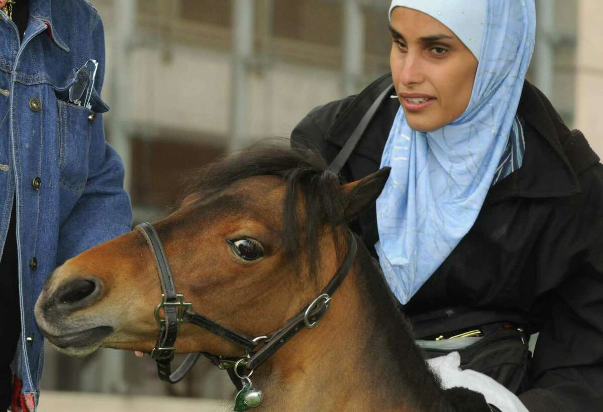Mona Ramouni, who is blind, following her arrival at Albany International Airport with Cali her guide horse in Latham N.Y. Tuesday June 26, 2012. (Michael P. Farrell/Times Union)