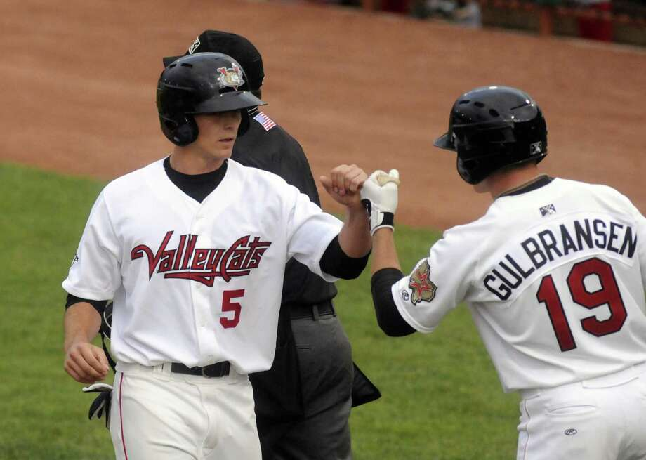 ValleyCats Austin Elkins gets a fist bump from Dan Gulbransen after scoring a run during their game against Lowell at Joseph L. Bruno Stadium in Troy N.Y. Tuesday June 26, 2012. (Michael P. Farrell/Times Union) Photo: Michael P. Farrell