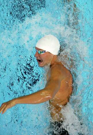 Peter Vanderkaay swims in the men's 200-meter freestyle preliminaries at the U.S. Olympic swimming trials, Tuesday, June 26, 2012, in Omaha, Neb. (AP Photo/Mark Humphrey) Photo: Associated Press