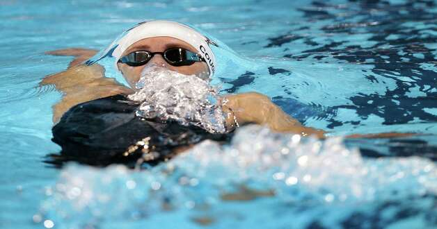 Natalie Coughlin swims in the women's 100-meter backstroke preliminaries at the U.S. Olympic swimming trials, Tuesday, June 26, 2012, in Omaha, Neb. (AP Photo/David J. Phillip) Photo: Associated Press