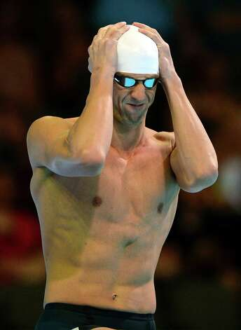 Michael Phelps prepares to swim in the men's 200-meter freestyle preliminaries at the U.S. Olympic swimming trials, Tuesday, June 26, 2012, in Omaha, Neb. (AP Photo/Mark J. Terrill) Photo: Associated Press