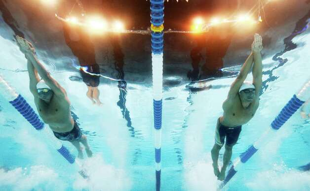 Ryan Lochte, left, and Ricky Berens swim in the men's 200-meter freestyle preliminaries at the U.S. Olympic swimming trials, Tuesday, June 26, 2012, in Omaha, Neb. (AP Photo/Mark J. Terrill) Photo: Associated Press
