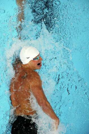 Ryan Lochte swims in the men's 200-meter freestyle preliminaries at the U.S. Olympic swimming trials, Tuesday, June 26, 2012, in Omaha, Neb. (AP Photo/Mark Humphrey) Photo: Associated Press