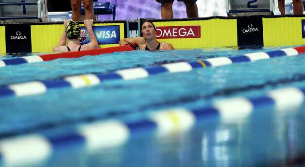Janet Evans looks at the time after swimming in the women's 400-meter freestyle preliminaries at the U.S. Olympic swimming trials, Tuesday, June 26, 2012, in Omaha, Neb. (AP Photo/David J. Phillip) Photo: Associated Press