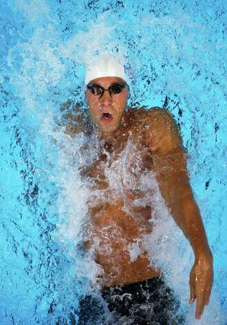 Matt Grevers swims in the men's 100-meter backstroke preliminaries at the U.S. Olympic swimming trials, Tuesday, June 26, 2012, in Omaha, Neb. (AP Photo/Mark Humphrey) Photo: Associated Press