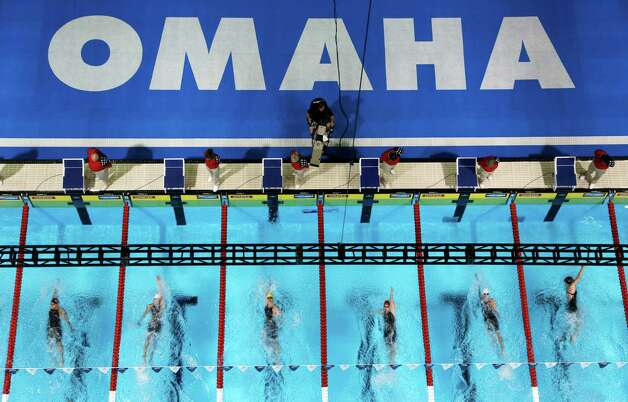 Swimmers compete in the women's 100-meter backstroke preliminaries at the U.S. Olympic swimming trials, Tuesday, June 26, 2012, in Omaha, Neb. (AP Photo/Mark Humphrey) Photo: Associated Press