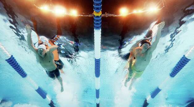Peter Vanderkaay, left, and Matt�McLean swim in the men's 200-meter freestyle preliminaries at the U.S. Olympic swimming trials, Tuesday, June 26, 2012, in Omaha, Neb. (AP Photo/Mark J. Terrill) Photo: Associated Press