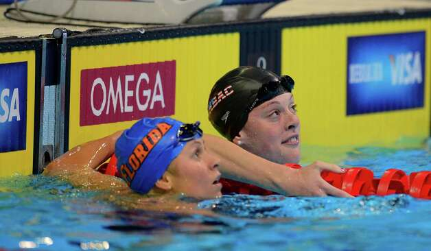 Elizabeth Beisel and Allison Schmitt look at the time after swimming in the women's 400-meter freestyle preliminaries at the U.S. Olympic swimming trials, Tuesday, June 26, 2012, in Omaha, Neb. (AP Photo/Mark J. Terrill) Photo: Associated Press