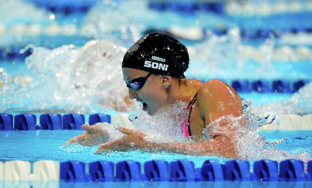 Rebecca Soni swims in the women's 100-meter breaststroke semifinal at the U.S. Olympic swimming trials, Tuesday, June 26, 2012, in Omaha, Neb. (AP Photo/Mark J. Terrill) Photo: Associated Press