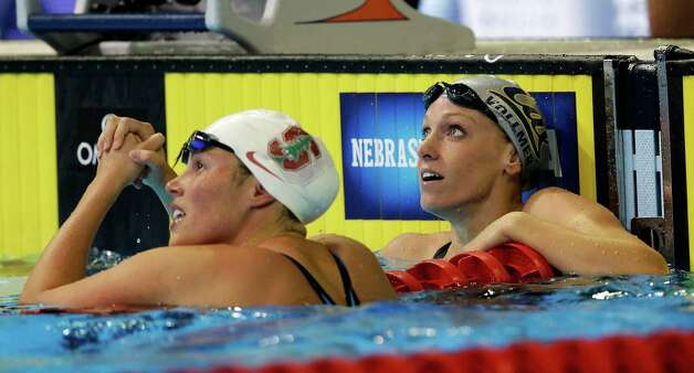 Elaine�Breeden, left, and Dana Vollmer check the time after swimming in the women's 100-meter butterfly final at the U.S. Olympic swimming trials, Tuesday, June 26, 2012, in Omaha, Neb. Vollmer won the final. (AP Photo/David J. Phillip) Photo: Associated Press
