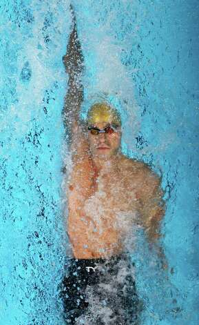 Nick Thoman swims in a men's 100-meter backstroke semifinal at the U.S. Olympic swimming trials, Tuesday, June 26, 2012, in Omaha, Neb. (AP Photo/Mark Humphrey) Photo: Associated Press