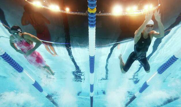 Rebecca Soni, left, and Jessica Hardy swim in a women's 100-meter breaststroke semifinal at the U.S. Olympic swimming trials, Tuesday, June 26, 2012, in Omaha, Neb. (AP Photo/Mark J. Terrill) Photo: Associated Press