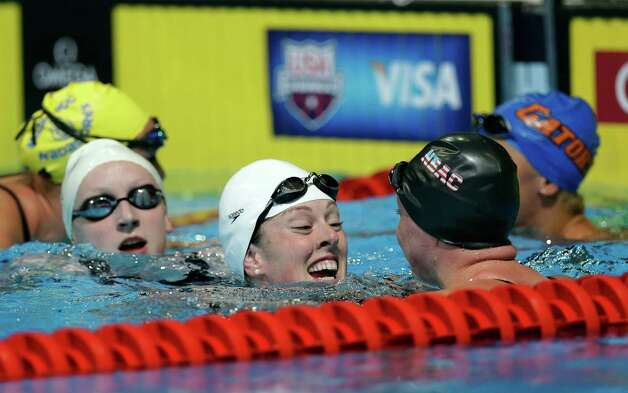 Allison Schmitt, center, is congratulated by her fellow swimmers after winning the women's 400-meter freestyle final at the U.S. Olympic swimming trials, Tuesday, June 26, 2012, in Omaha, Neb. (AP Photo/David J. Phillip) Photo: Associated Press