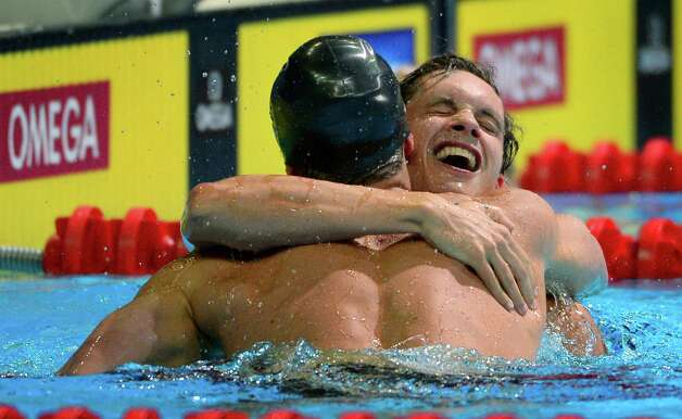 Brendan�Hansen, left, is congratulated by Eric Shanteau after winning the men's 100-meter breaststroke final at the U.S. Olympic swimming trials, Tuesday, June 26, 2012, in Omaha, Neb. (AP Photo/Mark J. Terrill) Photo: Associated Press