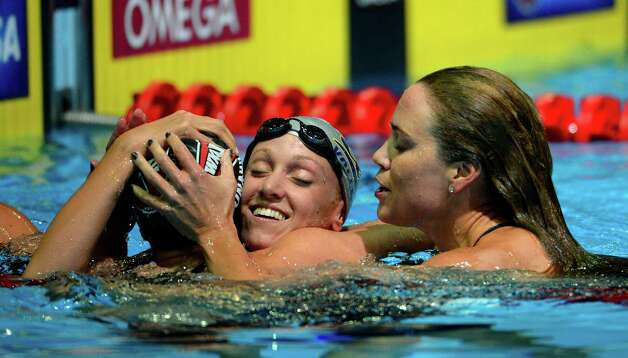 Claire Donahue, left, and Natalie Coughlin, right, congratulate Dana Vollmer for winning the women's 100-meter butterfly final at the U.S. Olympic swimming trials, Tuesday, June 26, 2012, in Omaha, Neb. (AP Photo/Mark J. Terrill) Photo: Associated Press