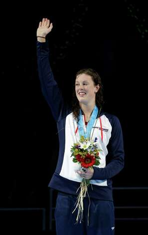 Allison Schmitt waves during the medal ceremony after winning the women's 400-meter freestyle final at the U.S. Olympic swimming trials, Tuesday, June 26, 2012, in Omaha, Neb. (AP Photo/David J. Phillip) Photo: Associated Press