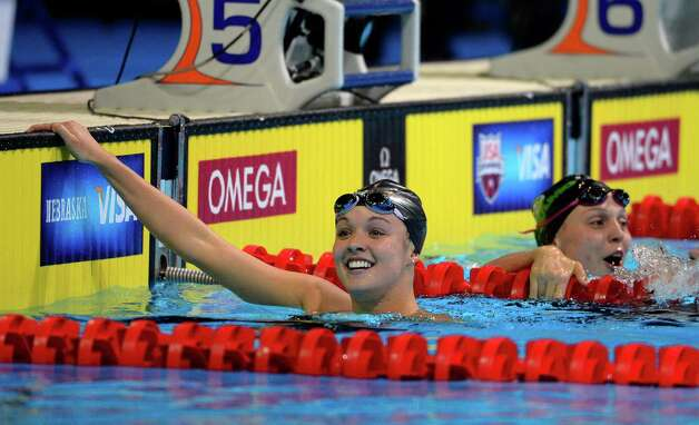 Rachel Bootsma smiles after swimming in a women's 100-meter backstroke semifinal at the U.S. Olympic swimming trials, Tuesday, June 26, 2012, in Omaha, Neb. (AP Photo/Mark J. Terrill) Photo: Associated Press