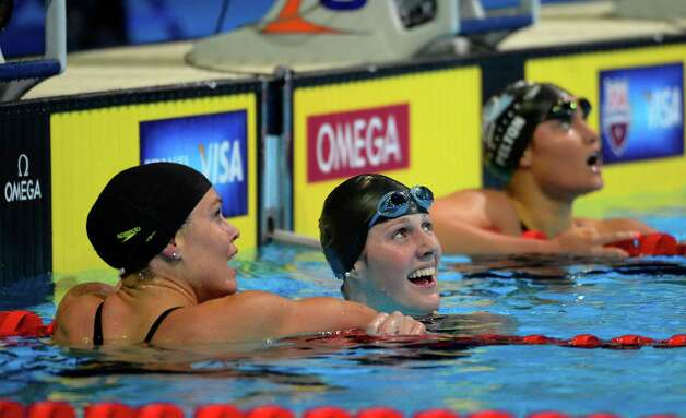 Natalie Coughlin, left, congratulates Missy Franklin after swimming in a women's 100-meter backstroke semifinal at the U.S. Olympic swimming trials, Tuesday, June 26, 2012, in Omaha, Neb. Franklin won the heat. (AP Photo/Mark J. Terrill) Photo: Associated Press