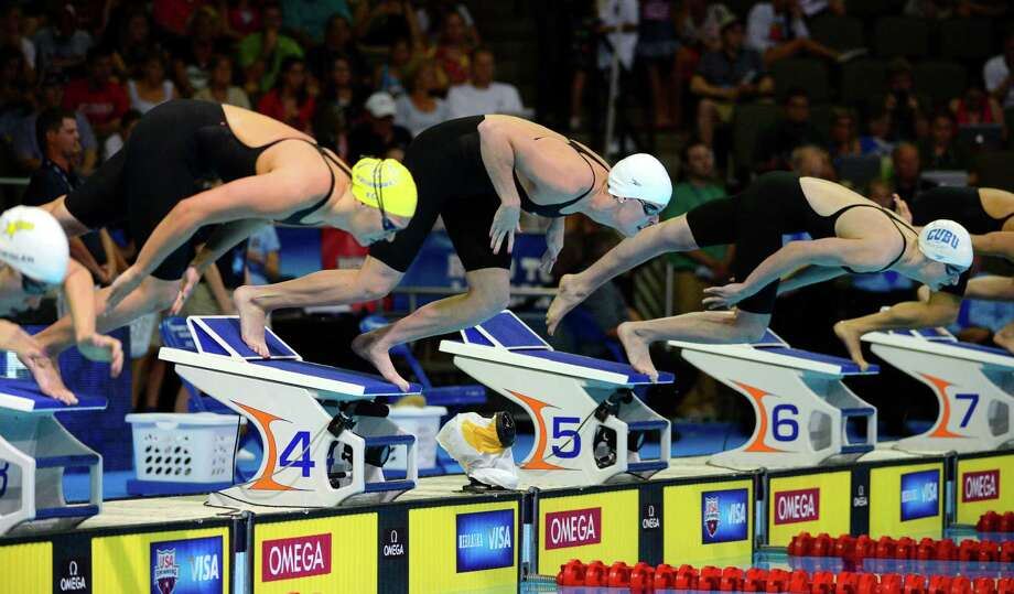 Chloe Sutton, from left, Allison Schmitt and Kathleen Ledecky start in the women's 400-meter freestyle final at the U.S. Olympic swimming trials, Tuesday, June 26, 2012, in Omaha, Neb. Schmitt won the final. (AP Photo/Mark J. Terrill) Photo: Associated Press
