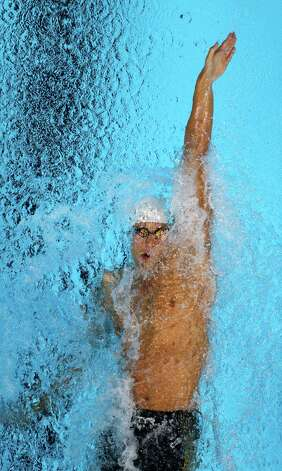 Matt Grevers swims in a men's 100-meter backstroke semifinal at the U.S. Olympic swimming trials, Tuesday, June 26, 2012, in Omaha, Neb. (AP Photo/Mark Humphrey) Photo: Associated Press