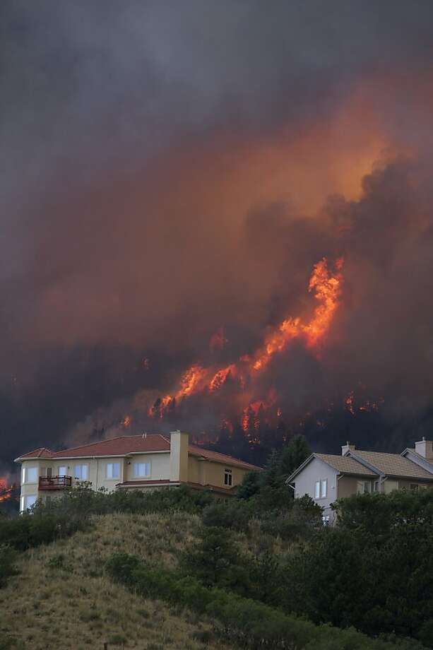 Fire from the Waldo Canyon wildfire as it moved into subdivisions and destroyed homes in Colorado Springs, Colo., on Tuesday, June 26, 2012. (AP Photo/Gaylon Wampler) Photo: Galon Wampler, Associated Press