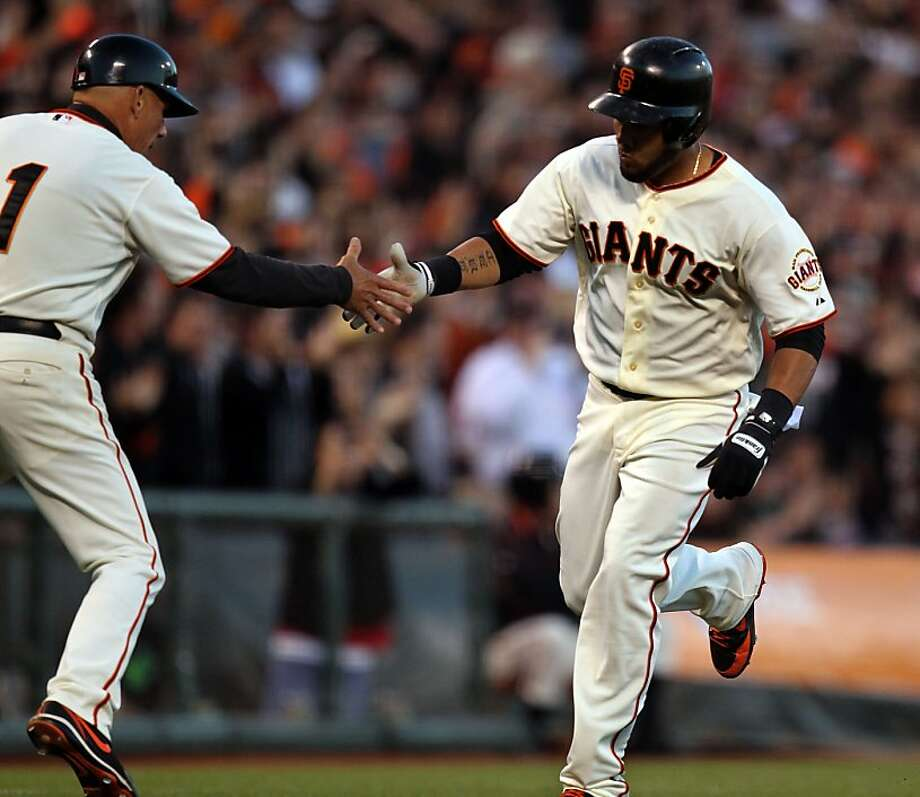 San Francisco Giants third base coach Tim Flannery extends his hand to Melky Cabrera after hitting a home run against the Los Angeles Dodgers Tuesday June 26, 2012 at AT&T Park in San Francisco Calif. Photo: Lance Iversen, The Chronicle