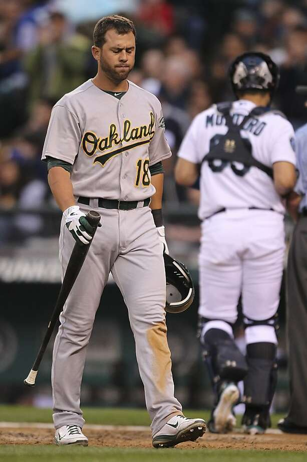 SEATTLE, WA - JUNE 26:  Brandon Hicks #18 of the Oakland Athletics heads back to the dugout after striking out to end the top of the sixth inning against the Seattle Mariners at Safeco Field on June 26, 2012 in Seattle, Washington.(Photo by Otto Greule Jr/Getty Images) Photo: Otto Greule Jr, Getty Images