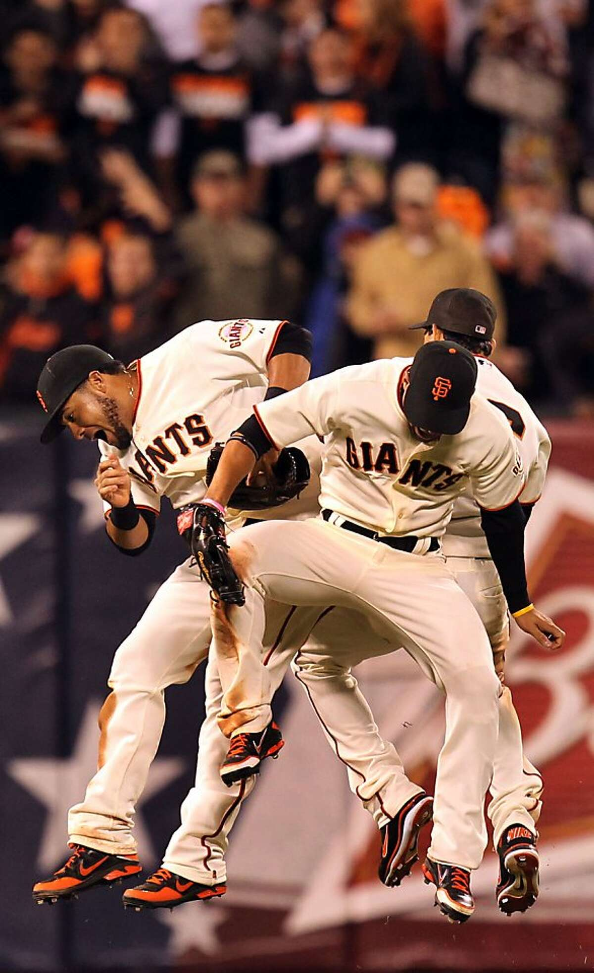 San Francisco Giants Melky Cabrera, Angel Pagan and Gregor Blanco celebrate their 2-0 win over the Los Angeles Dodgers Tuesday June 26, 2012 at AT&T Park in San Francisco Calif.