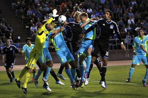 Seattle Sounders goalie Andrew Weber, left, makes the save as the San Jose Earthquakes Steven Lenhart, center, and Alan Gordon, right, #16, try to score late in their game in San Francisco, Calif., Tuesday, June 26, 2012.  The Seattle Sounders won 1-0. Photo: Sarah Rice, Special To The Chronicle
