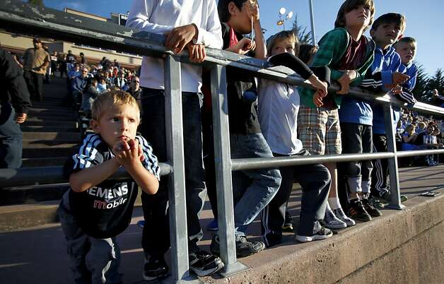 Luca Esser, 2, of San Francisco, left, waits for the San Jose Earthquakes to take the field at Kezar Stadium in San Francisco, Calif., Tuesday, June 26, 2012.  His team lost to the Seattle Sounders 1-0. Photo: Sarah Rice, Special To The Chronicle