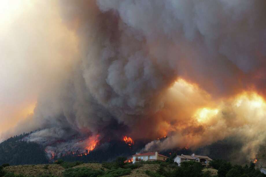 Fire from the Waldo Canyon wildfire burns as it moved into subdivisions and destroyed homes in Colorado Springs, Colo., on Tuesday, June 26, 2012. (AP Photo/Gaylon Wampler) Photo: Galon Wampler, FRE
