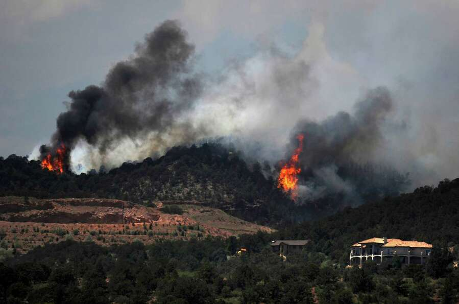 The Waldo Canyon wildfire continues to grow in Colorado Springs, Colo, Tuesday, June 26, 2012. Telle