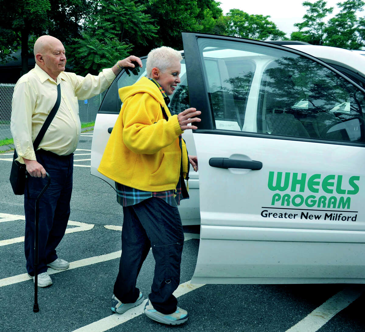 Bill Lowenthal and Maxine Hayes get in a Wheels car Tuesday, June 12, 2012 in New Milford to be driven to doctors' appointments by volunteer Roland Miller