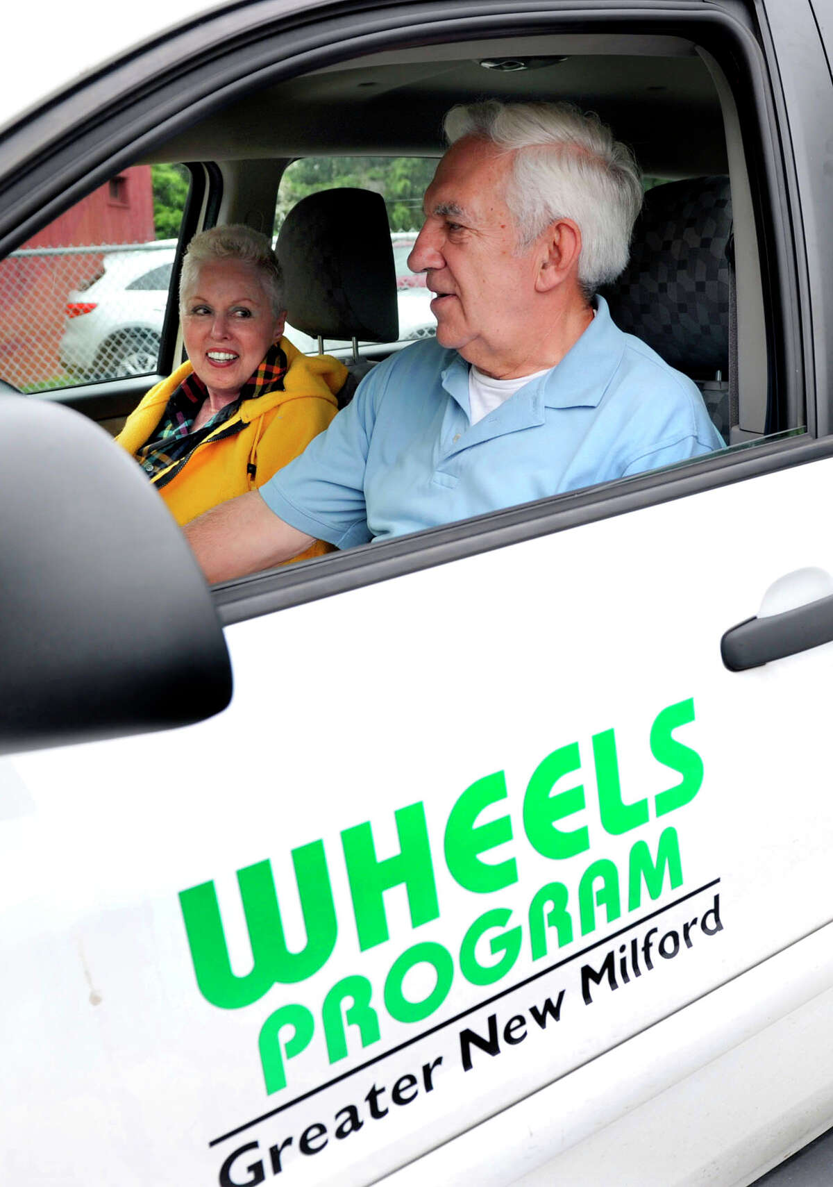 Maxine Hayes of New Milford is provided with a ride by volunteer Roland Miller on Tuesday, June 12, 2012. The Wheels program provides seniors with rides to doctor appointments.