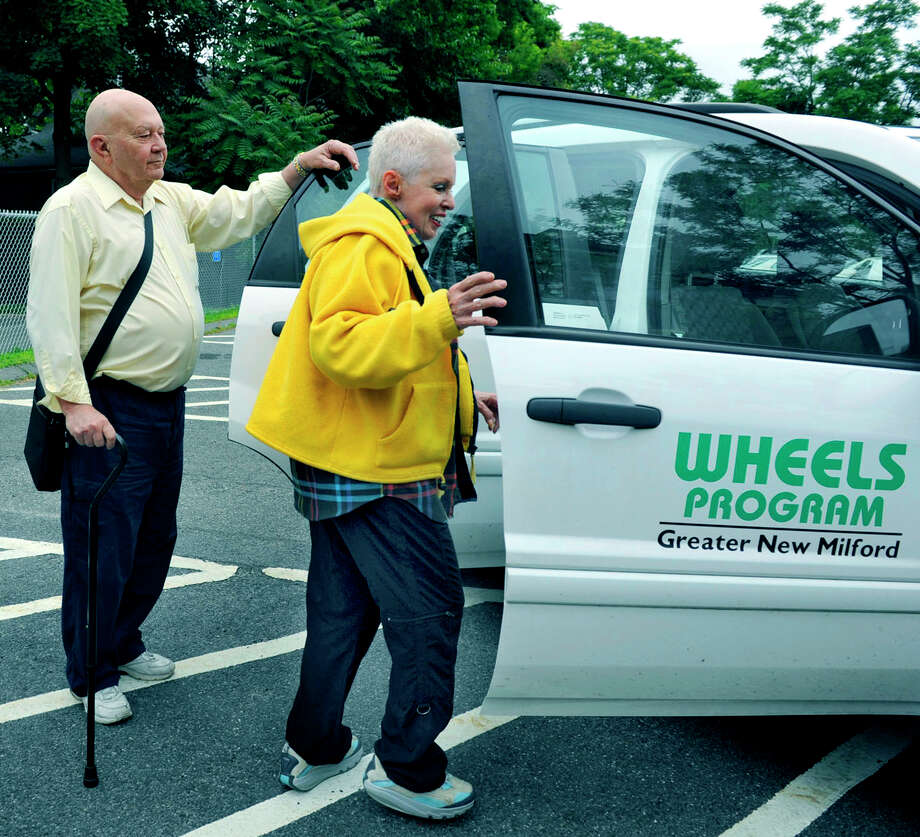 Bill Lowenthal and Maxine Hayes get in a Wheels car Tuesday, June 12, 2012 in New Milford to be driven to doctors' appointments by volunteer Roland Miller Photo: Carol Kaliff / The News-Times