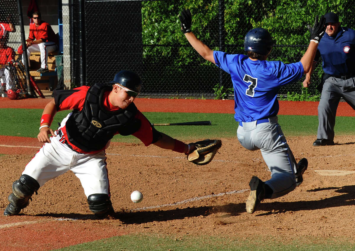 Norwalk catcher Danny Diaz fails to tag out Darien/New Canaan's #7 Brian Previte, who hit an in the park grand slam home run, during American Legion baseball action in Darien, Conn. on Tuesday June 26, 2012.