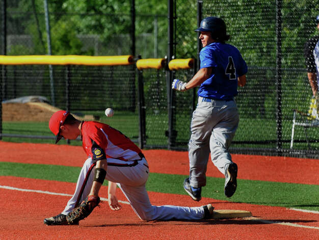 Norwalk's #19 James Welch misses the ball at first allowing Darien/New Canaan's #4 Matt Sammarco to get on base, during American Legion baseball action in Darien, Conn. on Tuesday June 26, 2012. Photo: Christian Abraham / Connecticut Post