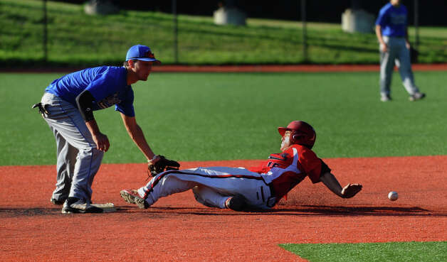 Norwalk's #15 Spencer Jacony steals second base as Darien/New Canaan's #1Tommy Forese attempt to make the tag, during American Legion baseball action in Darien, Conn. on Tuesday June 26, 2012. Photo: Christian Abraham / Connecticut Post