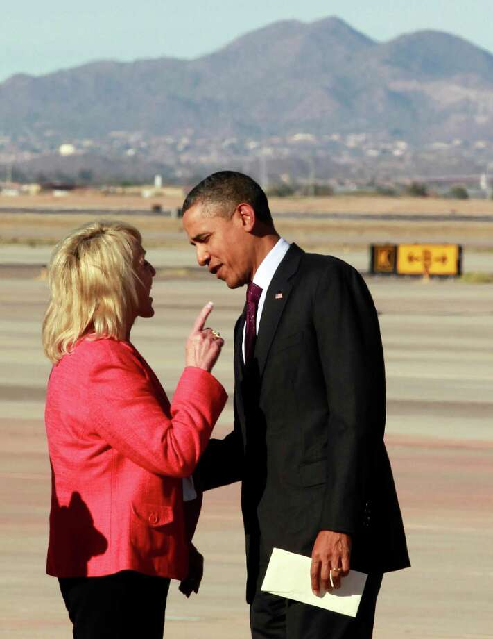 Arizona Gov. Jan Brewer points at President Barack Obama after he arrived at Phoenix-Mesa Gateway Airport, in Mesa, Ariz., in January. The Supreme Court on Monday struck down most of Arizona's controversial immigration law. Photo: AP