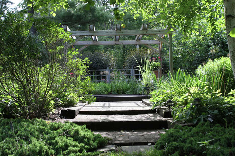 Judy Bodner of Rensselaer used fond childhood memories as an inspiration for her gardens, employing smaller dimensions and creating intentional surprises around each corner.  Read the story  here . Photo: Krishna Hill/Life@Home