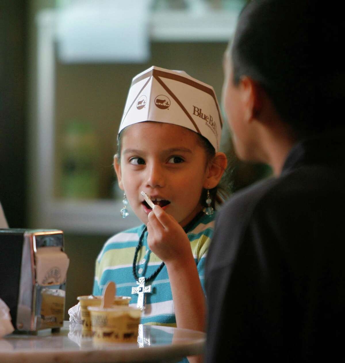 Jacquelynn Arteaga, age 7, has some Blue Bell ice cream with her cousin, Jesus Leon, 14, after taking a tour of the Blue Bell facilities in Brenham, Dec. 28, 2006.  Photo by Steve Campbell, Chronicle Staff