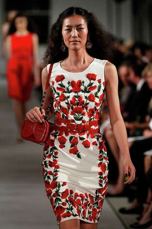 What not to wear: A floral print dress, like this one from Oscar de la Renta, is always a summertime favorite but for the office the look is more social than professional. Save the look for after five. Photo: Peter Michael Dills, Stringer / 2011 Getty Images